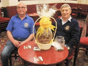 Lion Don and Lion Paul S. selling Easter Egg raffle tickets at Rothwell WMC