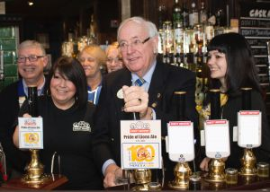 District Governor David McDowell pulls the first pint of the Centenniel Ale