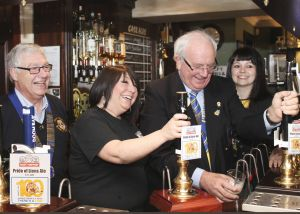 District Governor David McDowell pulls the first pint of the Lons Centenniel Ale