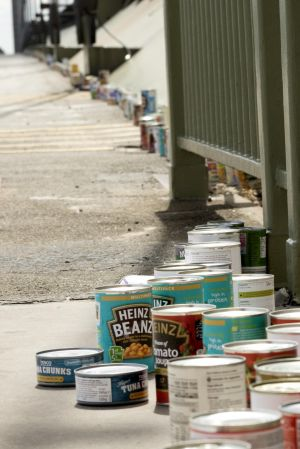 The tins are lined across the bridge.