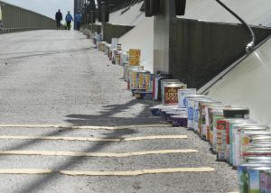 Lined up tins on the bridge