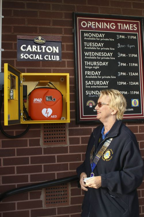 Lion president Janice and the new defibrillator