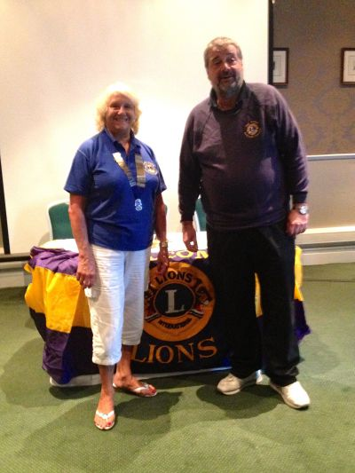 Outgoing Lion President Phil hands over to incoming Lion President Jackie