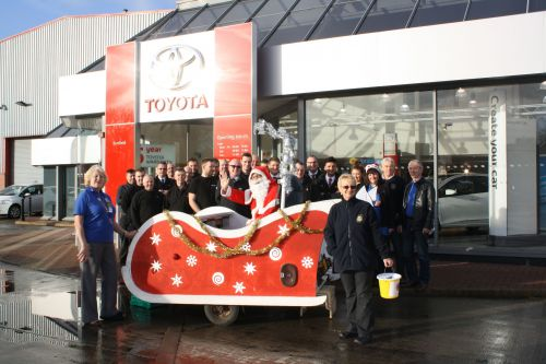 Benfield Toyota Motors staff and the Rothwell Lions Santa Sleigh